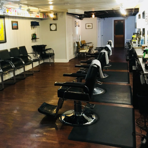 interior of blue spark barbershop